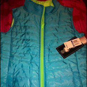 Girl's Reversible Vest. New. XL